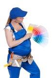 A mulher gravida em macacões de trabalho Imagem de Stock