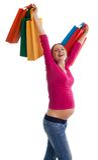 Mulher gravida feliz com sacos de compra Fotos de Stock Royalty Free
