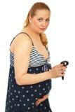 Mulher gravida que conta contrações imagens de stock royalty free
