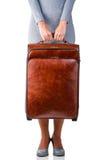 A mulher guarda a mala de viagem Fotografia de Stock Royalty Free