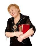 Mulher idosa com os livros nas mãos fotos de stock