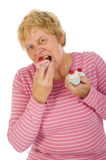 A mulher idosa está comendo Imagem de Stock Royalty Free