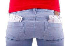 A mulher impede com preservativos Imagem de Stock