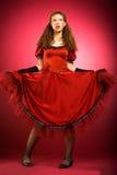 Mulher infantil no vestido vermelho imagem de stock royalty free