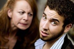 A mulher irritada olha um homem Imagens de Stock Royalty Free