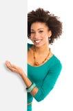 Jovem mulher que indica o cartaz Imagens de Stock