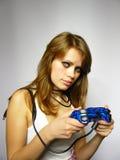 a mulher joga o jogo video Imagem de Stock Royalty Free