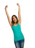 A mulher levantou suas mãos acima do olhar feliz do sucesso Imagem de Stock Royalty Free