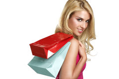 A mulher loura bonita feliz nova vai à compra Fotografia de Stock