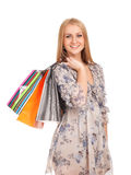 Mulher loura bonita que guardara sacos de compras Fotografia de Stock Royalty Free