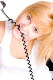 Mulher loura com telefone retro imagens de stock