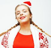 A mulher loura de sorriso consideravelmente feliz dos jovens no Natal no chapéu vermelho e no feriado de Santa decorou a manta, p Fotos de Stock Royalty Free