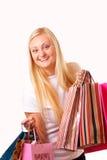 Mulher loura feliz com compras Fotografia de Stock Royalty Free