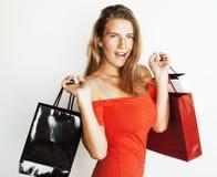 Mulher loura moderna nova com o levantamento diverso dos sacos emocional no fundo branco, venda, conceito dos povos do estilo de  Imagens de Stock Royalty Free