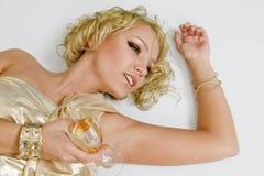 Mulher loura nova com vidro do champanhe Imagens de Stock