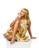 Mulher loura nova com vidro do champanhe Foto de Stock