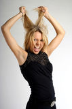 Mulher loura nova na raiva Fotografia de Stock
