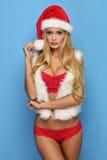A mulher loura nova 'sexy' gosta de Santa Claus Foto de Stock