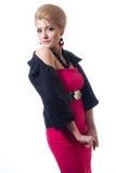 Mulher loura nova 'sexy' no vestido vermelho fotografia de stock