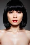 Mulher luxuosa com composição da forma & penteado do prumo foto de stock