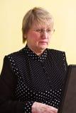 Mulher madura com portátil Fotografia de Stock