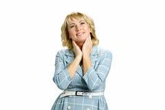 Mulher madura de sorriso que olha para cima fotografia de stock royalty free