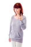 Mulher madura que aponta acima Imagem de Stock Royalty Free