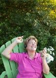 Mulher madura que sente a batida Fotos de Stock Royalty Free