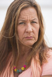 Mulher madura segura irritada exterior Foto de Stock Royalty Free