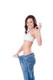 Mulher magro em calças de brim grandes Fotos de Stock