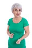 Mulher mais idosa feliz com o cabelo cinzento isolado no branco. Fotos de Stock