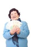 Mulher mais idosa feliz que prende euro- notas de banco Imagem de Stock