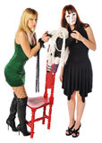 Mulher mascarada e uma boneca Imagem de Stock