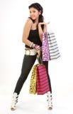 Mulher à moda que retorna com sacos de compra Fotos de Stock Royalty Free