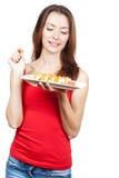 Mulher moreno bonita que come o sushi Fotos de Stock