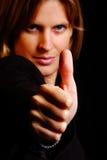 A mulher mostra o polegar Fotografia de Stock
