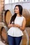 Mulher na adega de vinho Imagem de Stock Royalty Free