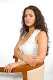 Mulher na blusa em uma cadeira Foto de Stock Royalty Free