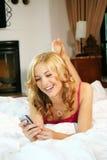 Mulher na cama em casa Imagens de Stock Royalty Free