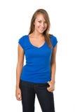 A mulher na camisa azul e na sarja de Nimes escura arfa Foto de Stock Royalty Free