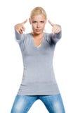Mulher que gesticula armas com suas mãos Fotografia de Stock Royalty Free