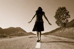 Mulher na estrada Imagem de Stock Royalty Free