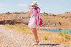 Mulher na estrada Imagens de Stock Royalty Free