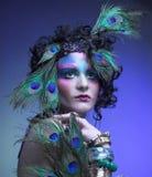 Mulher na imagem do pavão. fotografia de stock royalty free
