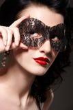 Mulher na máscara do carnaval imagem de stock