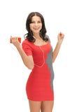 Mulher na música de escuta do vestido elegante Foto de Stock Royalty Free