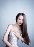 A mulher na película de plástico Imagens de Stock Royalty Free