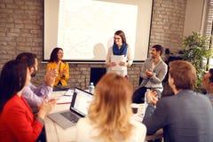 Mulher na reunião de negócios com grupo de executivos fotografia de stock royalty free