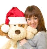 Mulher na roupa de Papai Noel com cão de brinquedo Fotografia de Stock