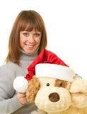 Mulher na roupa de Papai Noel com cão de brinquedo Imagens de Stock Royalty Free
